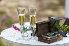 Wedding decor on the table. Box with rings.  Stock Photo