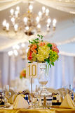 Wedding decor table setting and flowers. With linens Royalty Free Stock Images