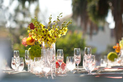 Wedding decor table setting and flowers. With linens Stock Photography
