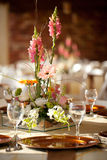 Wedding decor table setting and flowers. With linens Stock Photos