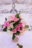 Wedding decor table setting and flowers. A Wedding decor table setting and flowers Stock Images