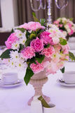 Wedding decor table setting and flowers. A Wedding decor table setting and flowers Royalty Free Stock Photography