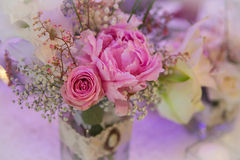 Wedding decor table setting and flowers. With linens Royalty Free Stock Photos