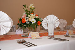 Wedding decor table setting and flowers. Table set for a wedding dinner with flowers and note Stock Photos