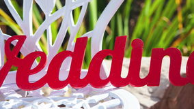 Wedding decor. Text. Wedding day on a white chair. RAW video record stock footage