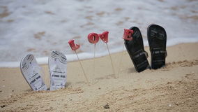 Wedding Decor in Tropical beach. Sandals and love letters on the beach running wave stock video