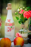 Wedding decor with wedding bottles in style of a shabby chic and Stock Photo