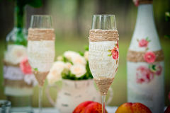 Wedding decor with wedding glasses in style of a shabby chic, bo Stock Photos