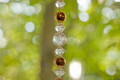 Wedding decor with wheel, glass beads and roses in bulbs Royalty Free Stock Image
