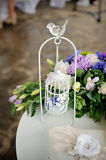Wedding decor, white with a bird cage Royalty Free Stock Photo