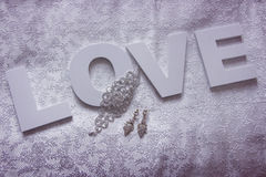 Wedding decor on white silk Stock Image