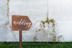Wedding decor. Wooden plaque with the inscription in paint Wedding. Wood hand made signboard, welcome wedding decoration