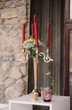 Wedding decorated candlestick with the vinous candles Stock Photos