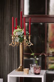 Wedding decorated candlestick with the vinous candles Stock Photography