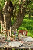 wedding decorated table, decor wedding dinner in nature in the garden stock photography