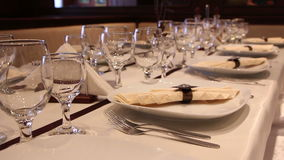 Wedding decorated table with glasses and cutlery stock video