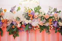 Wedding decorating bouquet of roses and petals, closeup. Wedding decorating bouquet of white, pink and orange roses and different petals, closeup Royalty Free Stock Image