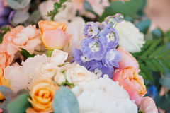 Wedding decorating bouquet of roses and petals, closeup. Wedding decorating bouquet of white, pink and orange roses and different petals, closeup Stock Image