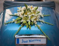 Wedding decoration. Flower bouquet used as a weeding decoration on a car. The number plate can be used for a message Royalty Free Stock Images
