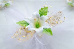 A wedding decoration an artificial white flower. stock photo