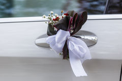 Wedding decoration attached to the car door handles Royalty Free Stock Photography