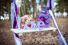 Wedding decoration of a beautiful delicate bouquet. Lying down on a swing Royalty Free Stock Photos