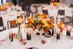 Wedding decoration. Bouquets of flowers. And candles on the table. Close-up Stock Photography