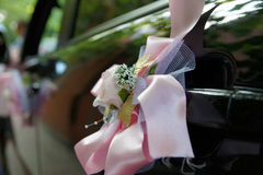 Wedding decoration on the car. Artificial bouquet of flowers on the car door Stock Photos
