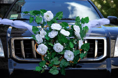Wedding decoration on the car. Artificial bouquet of flowers on the car door Royalty Free Stock Photography