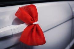 Wedding decoration on  car. Wedding decoration on wedding car, beautiful red bow Stock Photos