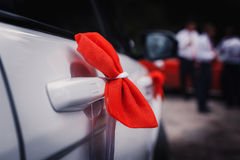 Wedding decoration on car. Wedding decoration on wedding car, beautiful red bow Royalty Free Stock Images