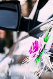 Wedding decoration on car. Rose bridal jewelry to wear on the machine handle Royalty Free Stock Photography