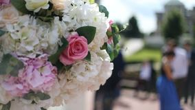 Wedding decoration ceremony Chandelier in the arch of flowers. Close up stock footage