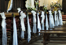 Wedding decoration church. Old Polish church indoor. Benches decorated for wedding Royalty Free Stock Photos