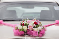 Wedding decoration closeup on the car. Royalty Free Stock Photo