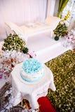 Wedding cake and wedded couple's seating stock image