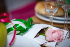 Wedding decoration. Devices with pink rose in linen napkin on table Stock Photo