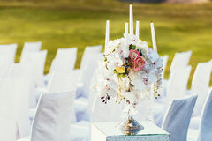 Wedding decoration with flowers and сandle on sunny day in cere Stock Image