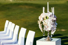 Wedding decoration with flowers and сandle on sunny day in cere Stock Photo
