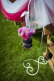 Wedding decoration of flowers on a green lawn Royalty Free Stock Photo