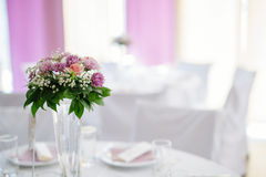 Wedding decoration with flowers in vase Stock Photography