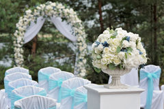 Wedding decoration in forest, vintage ceremony. Wedding vintage white and cyan decoration, ceremony in forest Royalty Free Stock Photo