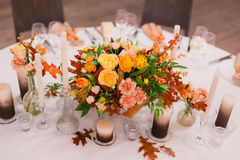 Wedding decoration of fresh flowers. And candles on the table Royalty Free Stock Images