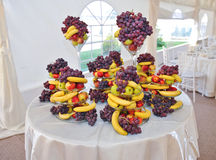 Wedding decoration with fruits, bananas, grapes and apples Royalty Free Stock Images