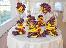 Wedding decoration with fruits, bananas, grapes and apples Stock Photos