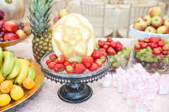 Wedding decoration with fruits on restaurant table, pineapple, bananas, nectarines, kiwi Stock Images