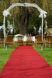 Wedding arch with red carpet Royalty Free Stock Photo