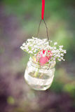 Wedding decoration of glas bottles with flowers Stock Images