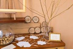 Wedding decoration. Golden walnut in a glass round vase. The wish tree. Wedding Royalty Free Stock Image