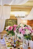 Wedding decoration of the holiday table of white and pink peonies royalty free stock images